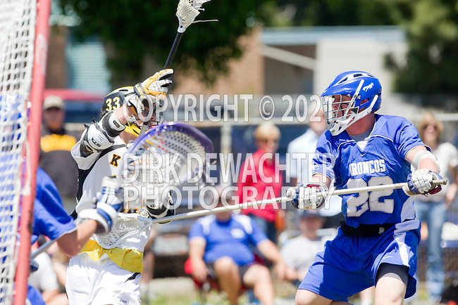 Santa Ana, CA 04/30/10 - Eric Adamson (Foothill-Santa Ana #33) and Jeremy Hutchens (Rancho Bernardo #22) in action during the Rancho Bernardo Broncos-Foothill Santa Ana Knights boys lacrosse game at Foothill High School.