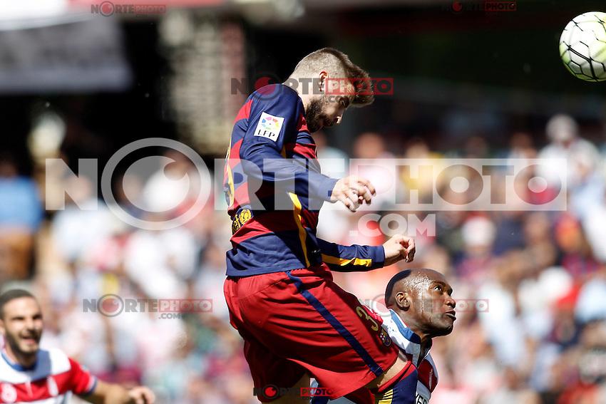 Granada's Jean-Sylvain Babin (r) and FC Barcelona's Gerard Pique during La Liga match. May 14,2016. (ALTERPHOTOS/Acero) /NortePhoto.com