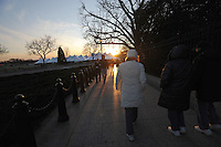 Tourists walk in front of the White House as hundreds of thousands are expected in the capitol ahead of Barack Obama's inauguration as the 44th U.S. President in Washington, DC on January 16, 2009.