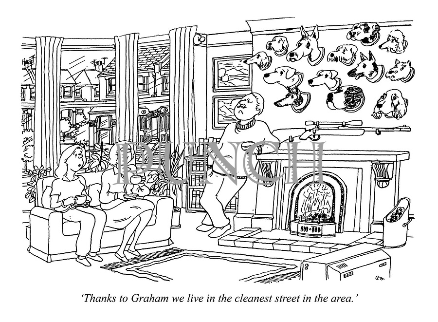 """""""Thanks to Graham we live in the cleanest street in the area."""" (a wife discusses her husband's hunting of dogs as he poses proudly infront of his hunting trophies above the fireplace)"""