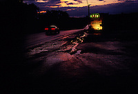 On a sultry night after a summer thunderstorm, a car races west on the National Road near Chalk Hill, PA. The historic road passes through the center of this small western PA town which was by passed by Interstate highways.