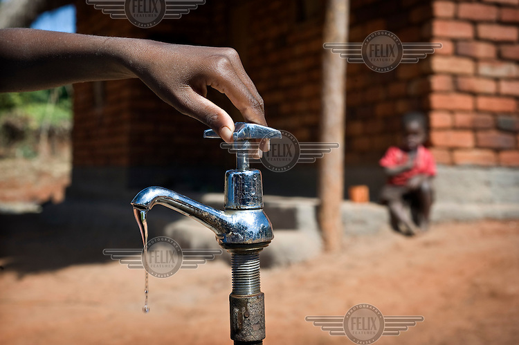 The new water tap in Ntalava village. ActionAid, along with the local women's group Chigwirizano, constructed a three kilometre long water pipeline providing clean water to Ntalava village and the surrounding area....