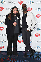 Romeo Stodart and David McAlmont<br /> at The Ivor Novello Awards 2017, Grosvenor House Hotel, London. <br /> <br /> <br /> &copy;Ash Knotek  D3267  18/05/2017