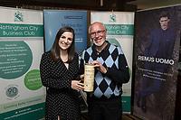 Denada Berisha of Remus Uomo gives a raffle prize to Philip Sale