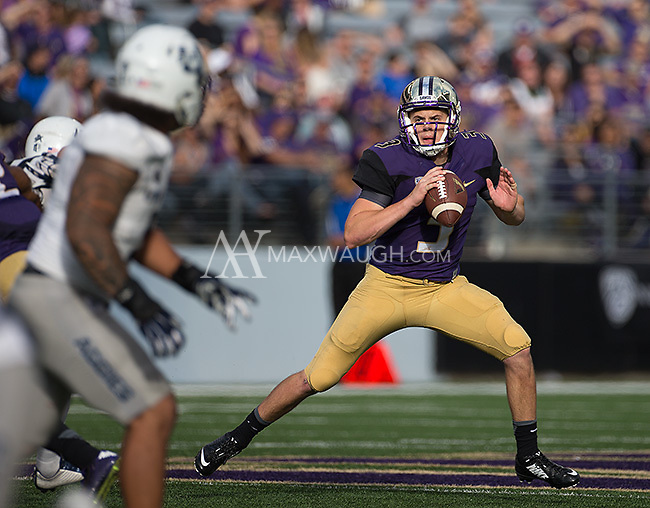 Jake Browning looks to pass.  Browning threw for 368 yards and three touchdowns.