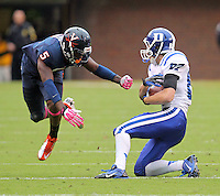 DUPLICATE***Virginia quarterback David Watford (5)***Virginia cornerback Tim Harris (5) Duke defeated Virginia 35-22 at Scott Stadium in Charlottesville, VA. . Photo/Andrew Shurtleff