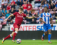 Ben Woodburn of Liverpool takes on Nathan Byrne of Wigan Athletic during the pre season friendly match between Wigan Athletic and Liverpool at the DW Stadium, Wigan, England on 14 July 2017. Photo by Andy Rowland.