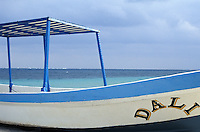 Fishing boat on the beach in Purto Morelos, Quintana Roo, Mexico
