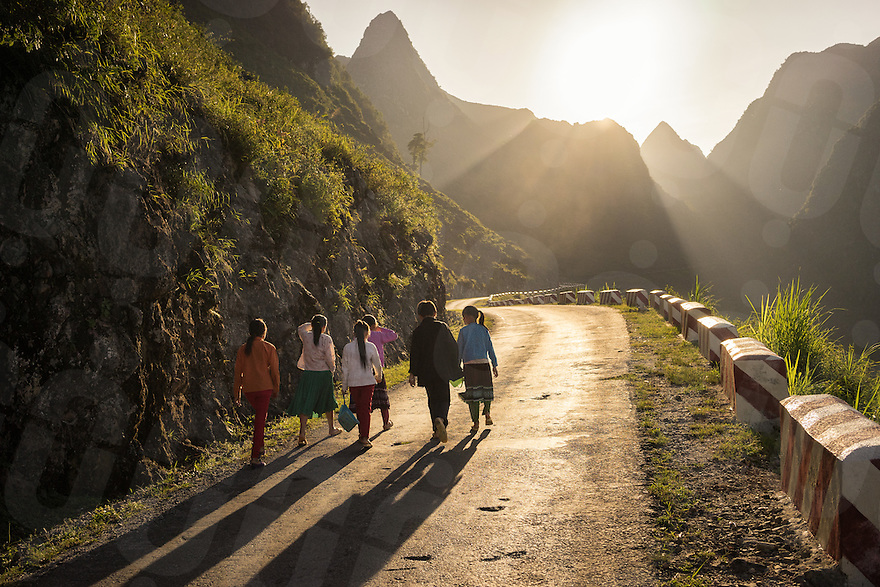 September 21, 2014 - Meo Vac (Vietnam). Kids walk back home after school, crossing the Ma Pi Leng Pass, between Dong Van and Meo Vac. © Thomas Cristofoletti / Ruom