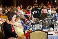 NWA Democrat-Gazette/JASON IVESTER<br /> Jackie Swope (from left), holds her daughter Grace Swope, 6, while reality tv star Willie Robertson prays with her husband Steve Swope Wednesday, May 17, 2017, during the Arkansas Chapter of the ALS Association Breakfast at Pinnacle Country Club in Rogers. Steve Swope was diagnosed with Amyotrophic Lateral Sclerosis in 2008.