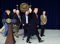 United States President Donald J. Trump waves as he departs after addressing the media at Camp David, the presidential retreat near Thurmont, Maryland, after holding meetings with staff, members of his Cabinet and Republican members of Congress to discuss the Republican legislative agenda for 2018 on January 6, 2018.  Pictured from left to right: US Senate Majority Leader Mitch McConnell (Republican of Kentucky); US Senate Majority Whip John Cornyn (Republican of Texas); US Vice President Mike Pence; US House Majority Whip Steve Scalise (Republican of Louisiana); and US Secretary of Defense James Mattis.<br /> CAP/MPI/RS<br /> &copy;RS/MPI/Capital Pictures