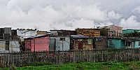 What the tourists see from the highway: Squattercamp in Gugulethu during cold winter times, Cape Town, SA 2009