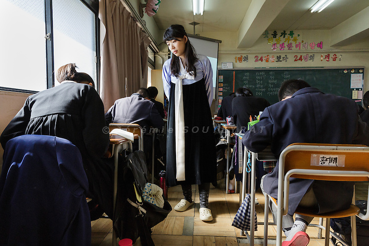 Osaka, Japan, November 25 2016 - An english teacher wearing a traditional dress during a class at East-Osaka Korean middle school (Higashi-Osaka chosen chugakko).<br /> 140 Korean schools are operated in Japan, including kindergartens and one university. The schools were initially funded by North Korea, but this money has dried up and the Japanese government has refused the Chosen Soren (General Association of Korean Residents in Japan with close ties to North Korea)&rsquo;s requests that it fund Korean schools.<br /> Professors at East-Osaka Korean middle school have not been paid for months.