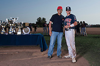 24 May 2009: Kenji Hagiwara of Rouen poses next to Claude Vicente with the MVP trophy during the 2009 challenge de France, a tournament with the best French baseball teams - all eight elite league clubs - to determine a spot in the European Cup next year, at Montpellier, France. Rouen wins 7-5 over Savigny.