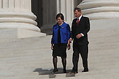 Supreme Court Chief Justice John Roberts and Supreme Court Associate justice Elena Kagan pose and walk down the steps of the Supreme Court after the investiture ceremony on October 1, 2010. .Credit: CNP