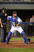 Bluefield Blue Jays catcher Andres Guerra (17) throws to second base in front of home plate umpire Adam Clark during the second game of a doubleheader against the Bristol Pirates on July 25, 2018 at Bowen Field in Bluefield, Virginia.  Bristol defeated Bluefield 5-2.  (Mike Janes/Four Seam Images)