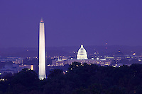 Monuments in Washington DC viewed from a distance at dusk. Washington Monument, Capitol Building.