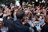 United States President Barack Obama greets people following a ceremony to honor the French and American Alliance, at a World War I Memorial at the Hotel de Ville in Cannes, France, November 4, 2011. .Mandatory Credit: Pete Souza - White House via CNP