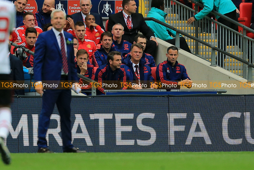 Manchester United manager Louis Van Gaal sit unanimated in the dugout during Crystal Palace vs Manchester United, Emirates FA Cup Final Football at Wembley Stadium on 21st May 2016