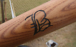 The team logo of the Belleville Stags burned into a baseball bat of one of the players.  Photo was taken during a game on August 4, 2012 at the Swansea Moose Lodge fields between the Belleville Stags and the St. Louis Unions.  Typical modern-day bats may be 33 inches in length, and weigh 31 ounces, but back in the late 19th century, they were longer (37 inches) and weighed a bit more (37 ounces).