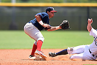 GCL Red Sox third baseman Rafael Oliveras (2) takes a throw as a runner slides in during a game against the GCL Rays on June 24, 2014 at Charlotte Sports Park in Port Charlotte, Florida.  GCL Red Sox defeated the GCL Rays 5-3.  (Mike Janes/Four Seam Images)
