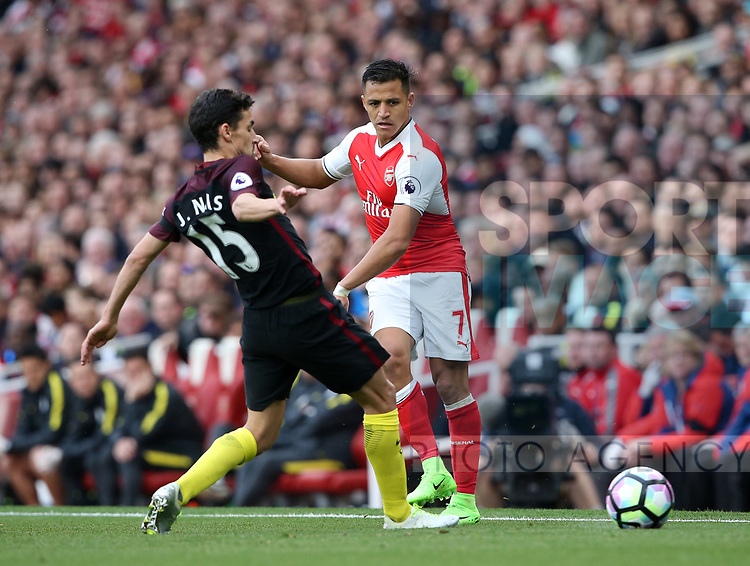 Arsenal's Alexis Sanchez tussles with Manchester City's Jesus Navas during the Premier League match at the Emirates Stadium, London. Picture date: April 2nd, 2017. Pic credit should read: David Klein/Sportimage