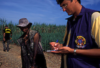 Contemporary slavery, sugarcane cutting, State: Mato Grosso do Sul, Brazil. Member of the Special Group for the Repression of Forced Labour (Grupo Especial de Repressão ao Trabalho Forçado) or GERTRAF, interviews sugarcane cutter. GERTRAF is made up of mobile groups that work in different regions of the country, investigating accusations of work conditions close to slavery. They are officials of the Ministry of Labour and they have support from the Federal Police.