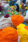 Marigold garlands for sale at a flower market, Kolkata, India