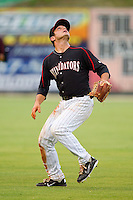 Shortstop Kyle Eveland #6 of the Kannapolis Intimidators tracks a fly ball into shallow left field against the Greensboro Grasshoppers at Fieldcrest Cannon Stadium on June 19, 2011 in Kannapolis, North Carolina.  The Intimidators defeated the Grasshoppers 9-7.   (Brian Westerholt / Four Seam Images)