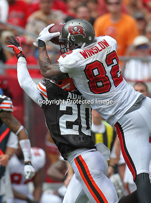 Tampa Bay Buccaneers Kellen Winslow and Cleveland Browns defensive back Mike Adams fight for the ball on a deep pass play.<br /> The Buccaneers defeated the Browns 17-14 in the opening NFL regular season game Sunday, Sept. 12, 2010 in Tampa,Fla. (AP Photo/Margaret Bowles)