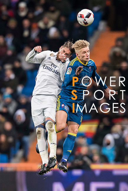 Sergio Ramos (l) of Real Madrid fights for the ball with Daniel Wass of RC Celta de Vigo during their Copa del Rey 2016-17 Quarter-final match between Real Madrid and Celta de Vigo at the Santiago Bernabéu Stadium on 18 January 2017 in Madrid, Spain. Photo by Diego Gonzalez Souto / Power Sport Images
