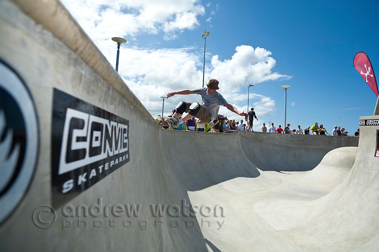 Man riding skateboard at skate park.  Cairns, Queensland, Australia