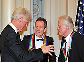 John Paul Jones, center, and Jimmy Page, right, of Led Zeppelin, two of the seven recipients of the 2012 Kennedy Center Honors share some thought with former United States President Bill Clinton following a dinner hosted by U.S. Secretary of State Hillary Rodham Clinton at the U.S. Department of State in Washington, D.C. on Saturday, December 1, 2012.  The 2012 honorees are Buddy Guy, actor Dustin Hoffman, late-night host David Letterman, dancer Natalia Makarova, and the British rock band Led Zeppelin (Robert Plant, Jimmy Page, and John Paul Jones)..Credit: Ron Sachs / CNP