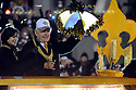 NEW ORLEANS - FEBRUARY 07:  New Orleans Saints owner Tom Benson and his wife Gayle Bensontreat fans to a Super Bowl Saints Victory parade on St. Charles Avenue in New Orleans, Tuesday, Feb. 9, 2010.  (Photo by Cheryl Gerber/Getty Images)