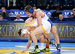 BROOKINGS, SD - JANUARY 18: Connor Brown from South Dakota State University has control of Drake Foster from Wyoming during their 125 pound match Thursday night at Frost Arena in Brookings. (Photo by Dave Eggen/Inertia)