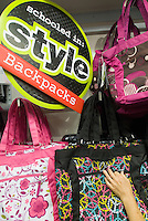 Backpacks and bags are promoted as back to school specials at the Midtown Manhattan JCPenney department store in New York on Thursday, August 6, 2009. July retail sales have been reported as sluggish because of consumers' money woes and retailers are concerned about the back-to-school shopping season. (© Richard B. Levine)