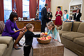 United States President Barack Obama and First Lady Michelle Obama visit with former Staff Sergeant Clinton Romesha and his family in the Oval Office prior to a ceremony to award Romesha the Medal of Honor, February 11, 2013. Remesha's family members, from left, are: son Colin Romesha, 2; daughter Gwen Romesha, 4; wife Tammy Romesha, daughter Dessi Romesha, 11; and mother Tish Rogers..Mandatory Credit: Pete Souza - White House via CNP