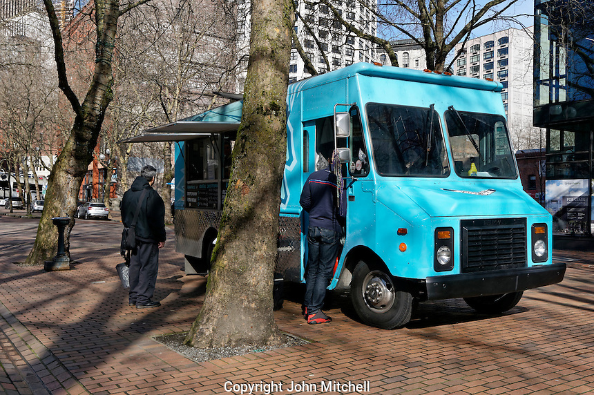 A food truck in Occidental Square Park  in the Pioneer Square district of Seattle, Washington, USA