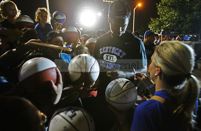 Freshman forward Julius Randle signs autographs for fans outside Memorial Coliseum in Lexington, Ky., on Thursday, October 3, 2013. Photo by Michael Reaves | Staff