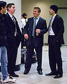 Matt McCollem (Harvard - 23), Chris Huxley (Harvard - 28), Kyle Richter (Harvard - 33) - The Harvard University Crimson defeated the Boston University Terriers 5-4 in the 2011 Beanpot consolation game on Monday, February 14, 2011, at TD Garden in Boston, Massachusetts.