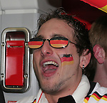 09 June 2006: A German fan sings on the subway on the way to the game. Germany played Costa Rica at the Allianz Arena in Munich, Germany in the opening match, a Group A first round game, of the 2006 FIFA World Cup.