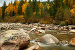 Boulders in the Pack River in autumn.