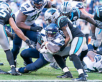 CHARLOTTE, NC - DECEMBER 15: Shaq Thompson #54 of the Carolina Panthers is unable to prevent Chris Carson #32 of the Seattle Seahawks from scoring a Seahawks touchdown during a game between Seattle Seahawks and Carolina Panthers at Bank of America Stadium on December 15, 2019 in Charlotte, North Carolina.