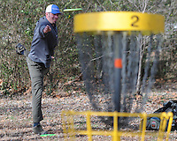 NWA Media/ J.T. Wampler - Ray Moore of Fayetteville putts Thursday Dec. 25, 2014 while playing disc golf with friends at Northshore Disc Golf Course along the north side of Lake Fayetteville. The course is open to the public and free to play all year.
