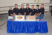 Houston, TX - February 22, 2008 -- The STS-123 crewmembers celebrate the end of formal crew training with a cake-cutting ceremony in the Jake Garn Simulation and Training Facility at Johnson Space Center in Houston, Texas on February 22, 2008. Pictured from the left are NASA astronauts Garrett E. Reisman, Robert L. Behnken, both mission specialists; Dominic L. Gorie, commander; Michael J. Foreman, mission specialist; Gregory H. Johnson, pilot; Japan Aerospace Exploration Agency (JAXA) astronaut Takao Doi and NASA astronaut Richard M. Linnehan, both mission specialists. Reisman is scheduled to join Expedition 16 as flight engineer after launching to the International Space Station on mission STS-123.  STS-123, flying aboard the Space Shuttle Endeavour, is scheduled for launch at 2:28 a.m. EDT Tuesday, March 11, 2008.  Its mission is to deliver the first pressurized component of the Japanese Kibo (Hope) Laboratory and a Canadian robotic device called Dextre utilizing 5 spacewalks.  Its 16-day flight is the longest shuttle mission to date..Credit: NASA via CNP