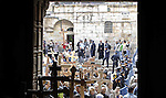 Orthodox Christians carry crosses as they enter the Church of the Holy Sepulchre after walk on the Via Dolorosa during the Good Friday processions retracing the route taken by Jesus Christ to his crucifixion, in Jerusalem's Old City on 10 April 2015. Photo by Saeb Awad