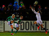 27.02.2015. Ashbourne Rugby Club, Ireland. Womens 6-Nations international. Ireland versus England. Niamh Briggs (Captain Ireland) kicks clear as Hannah Gallagher ( England) attempts to charge it down.
