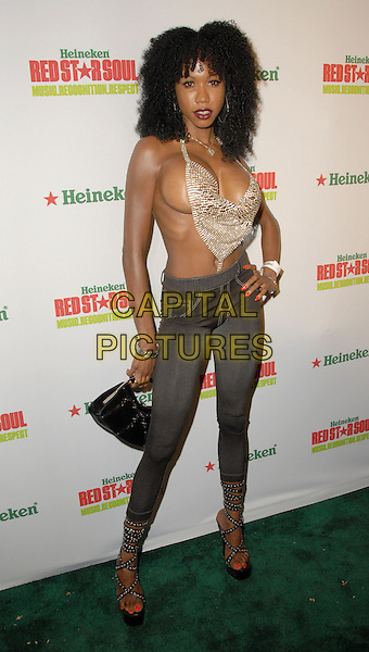 SHAUNA, Reality TV Personality.Heineken Red Star Soul held at Boulevard3, Hollywood, California, USA, 06 August 2008..full length boobs breasts gold chainmail top necklace cosmetic surgery boob job cleavage grey gray skinny jeans strappy sandals wedges shoes platforms hand on hip.CAP/ADM/FS.©Faye Sadou/Admedia/Capital Pictures