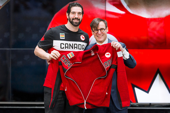 TORONTO, ON - FEBRUARY 11: Captain Greg Westlake, left, receives his Team Canada jacket from the President of the Canadian Paralympic Committee, Marc-André Fabien, right, as Hockey Canada reveals the players and coaching staff who will represent Team Canada in Men's Sledge Hockey at the upcoming Paralympic 2018 Winter Games in PyeongChang, South Korea on February 11, 2018 in the Atrium at the Canadian Broadcasting Corporation building in Toronto, Canada. (Photo by Adam Pulicicchio/Hockey Canada)