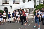 United States President Barack Obama hugs First Lady Michelle Obama after watching her jump rope for a double-dutch demonstration during a taping for the Presidential Active Lifestyle Award (PALA) challenge and Nickelodeon's Worldwide Day of Play, on the South Lawn of the White House, July 15, 2011. .Mandatory Credit: Pete Souza - White House via CNP